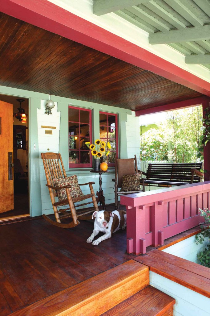 dog relaxes on the classic Craftsman porch