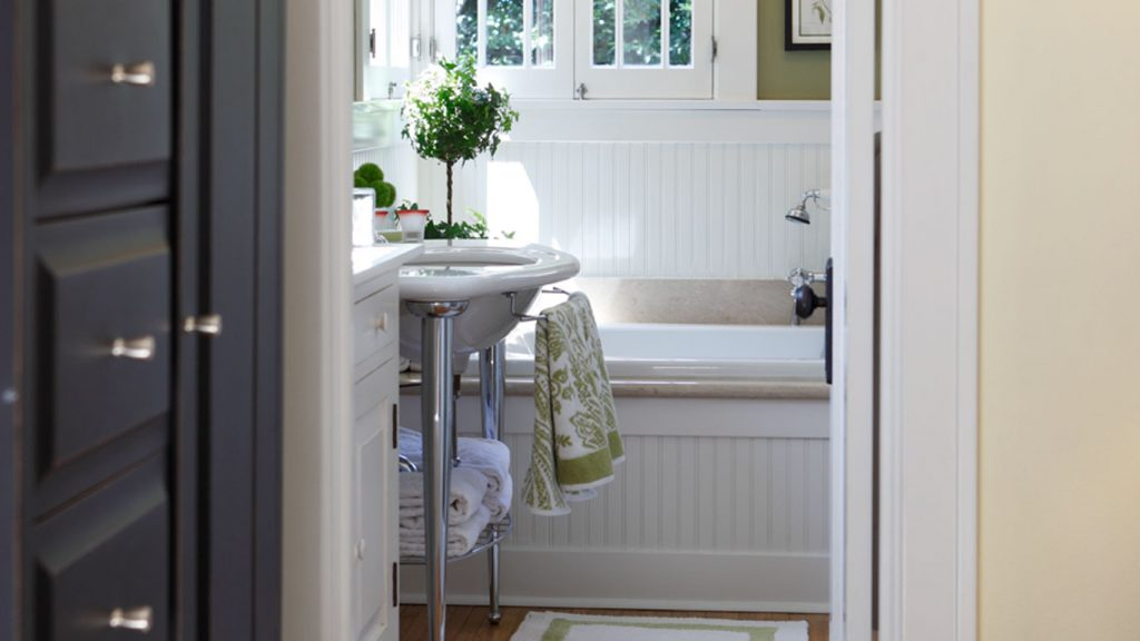 Custom bathroom featuring white beadboard.