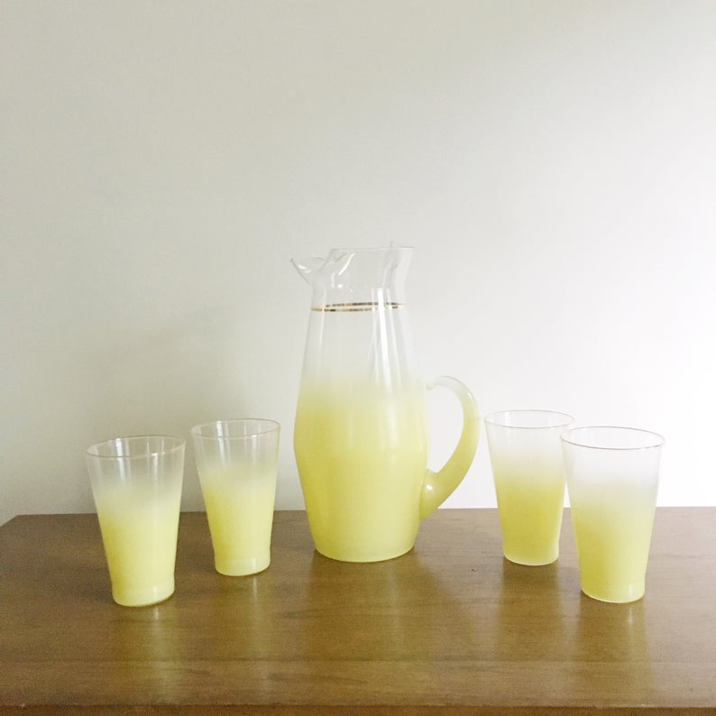 """1960's West Virginia Glass """"Blendo"""" Style Yellow Pitcher and Glassware Set on a wooden table"""