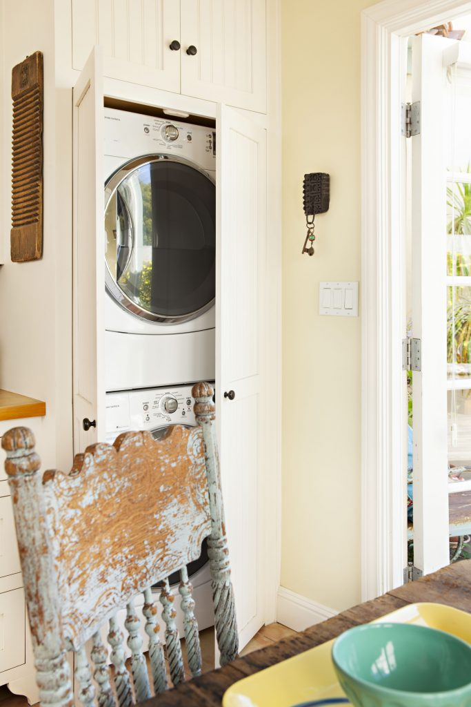 A concealed washer-dryer unit keeps the kitchen looking historic