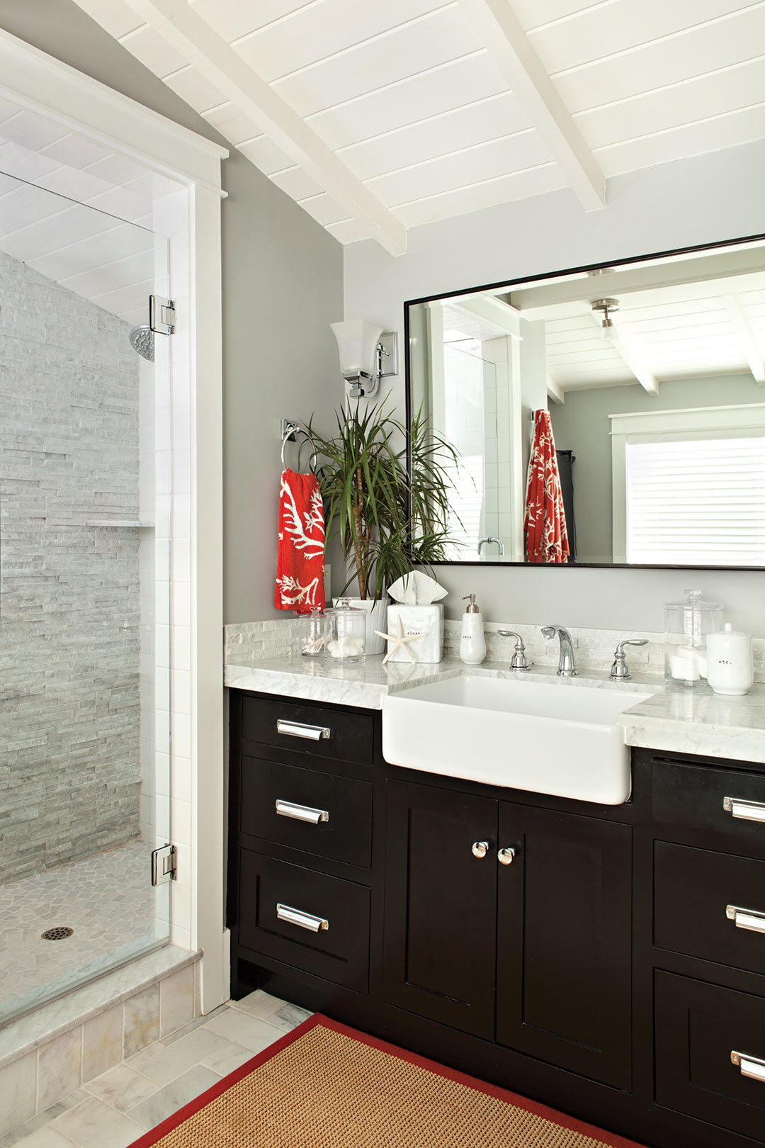 Master bathroom decor with dark wood cabinetry and a gray color scheme.