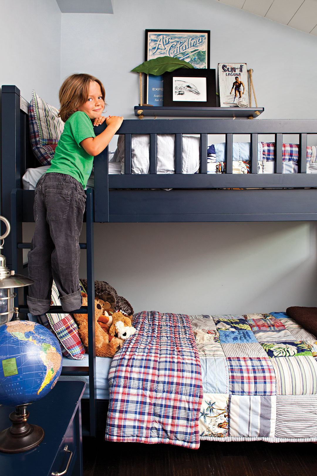 Boy's bedroom decor with navy blue bunk bed and plaid sheets
