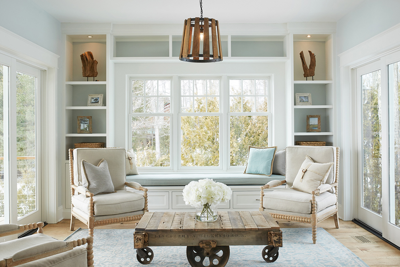 The Sunroom Ties In Beautifully With Great Room Dinning And Kitchen Its Airy Color Palette Country Inspired Details Like Light