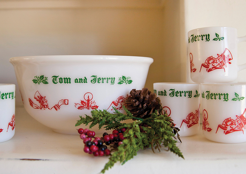 Vintage Tom and Jerry bowl and drink ware sets decorated with red and green.