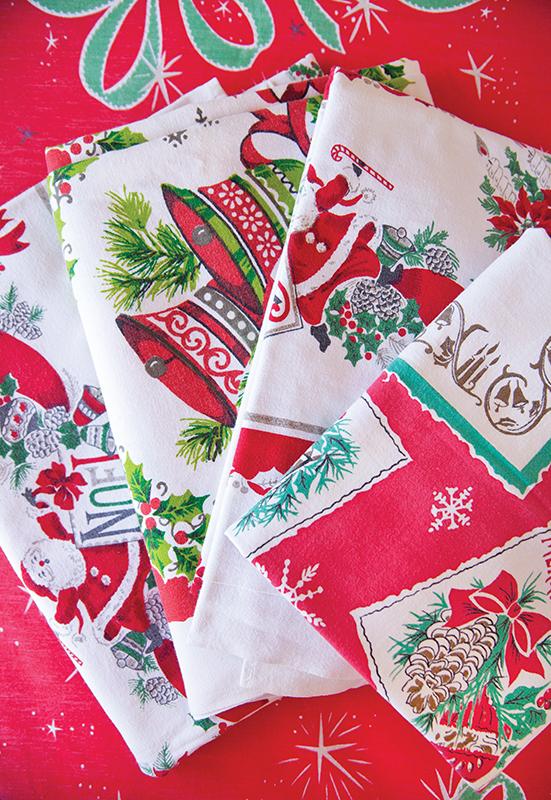 Festive vintage Christmas Wilendure tablecloth assortment.