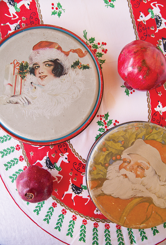 Vintage cookie tins featuring Santa and snow-filled themes.