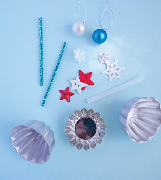 pipe cleaners, star buttons and mini ornaments are all ingredients for turning a mini candy mold into a new ornament
