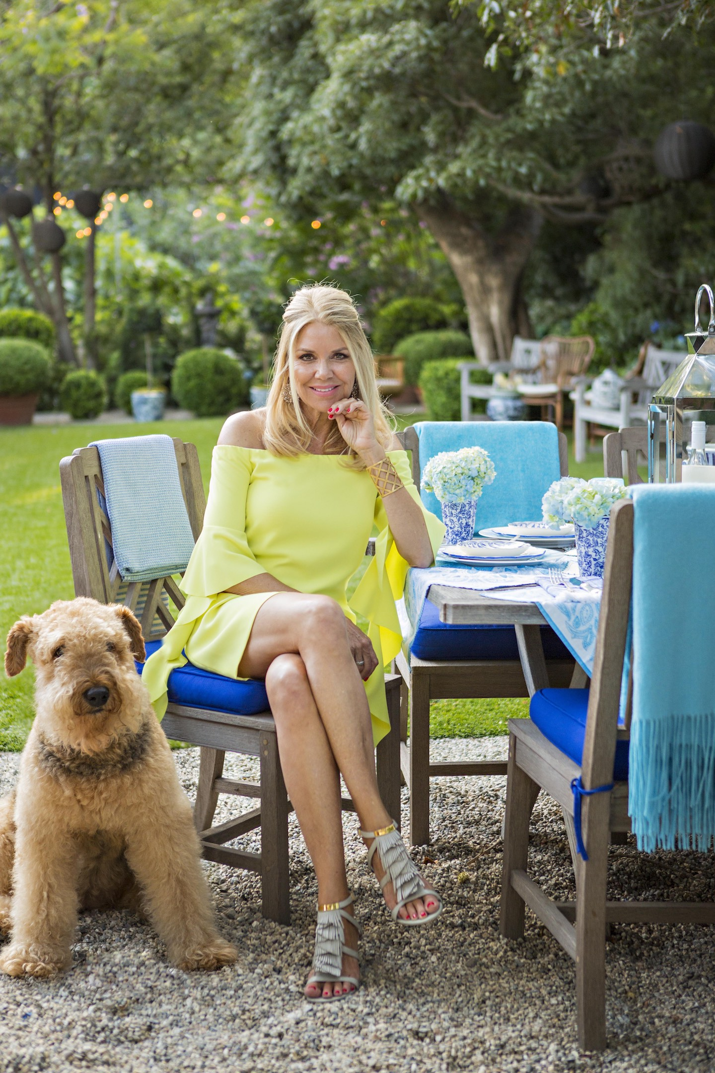 Teryl Ciarlo seated at her outdoor dining table.