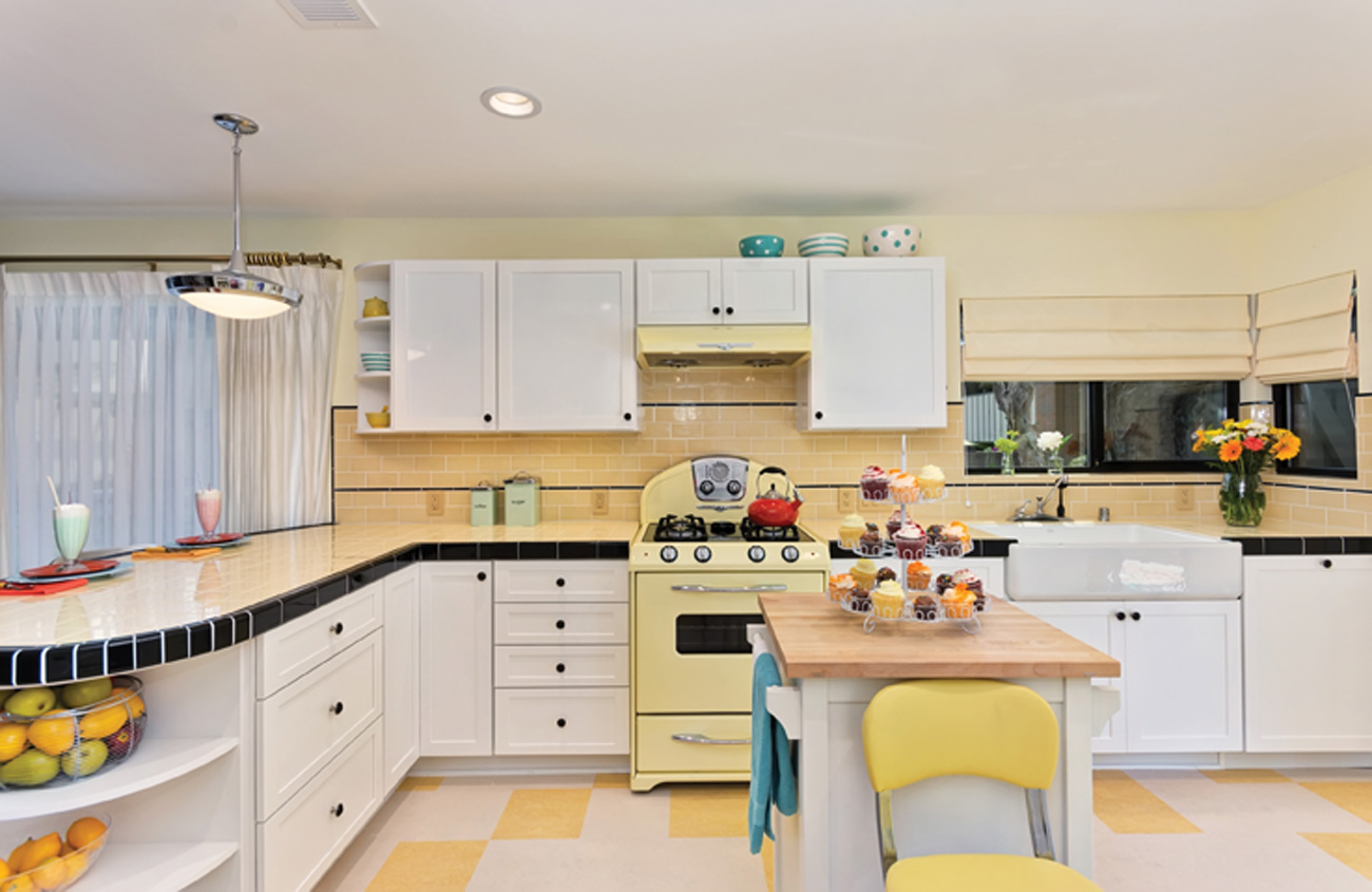 Yellow checkered kitchen floor with retro buttercup oven in a wide angled kitchen photo