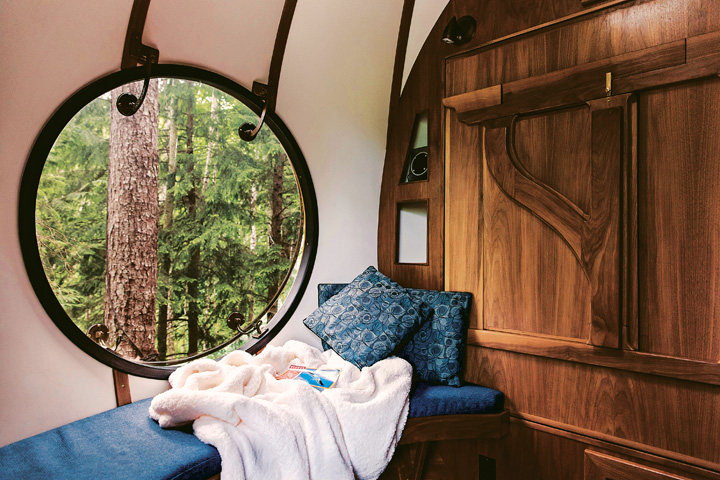 Cute porthole window in wooden fantasy treehouse