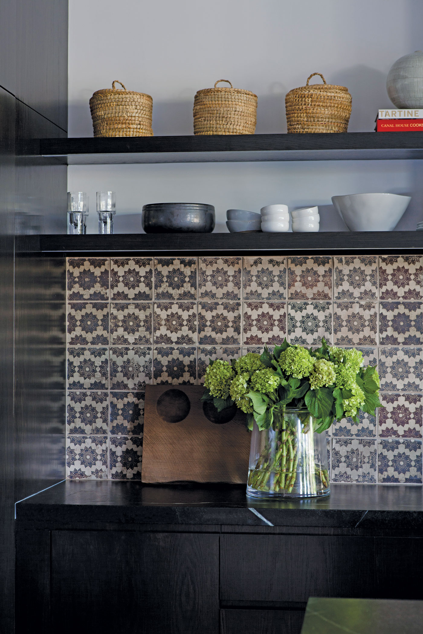 Dark Kitchen accents and tile backsplash with built in shelves