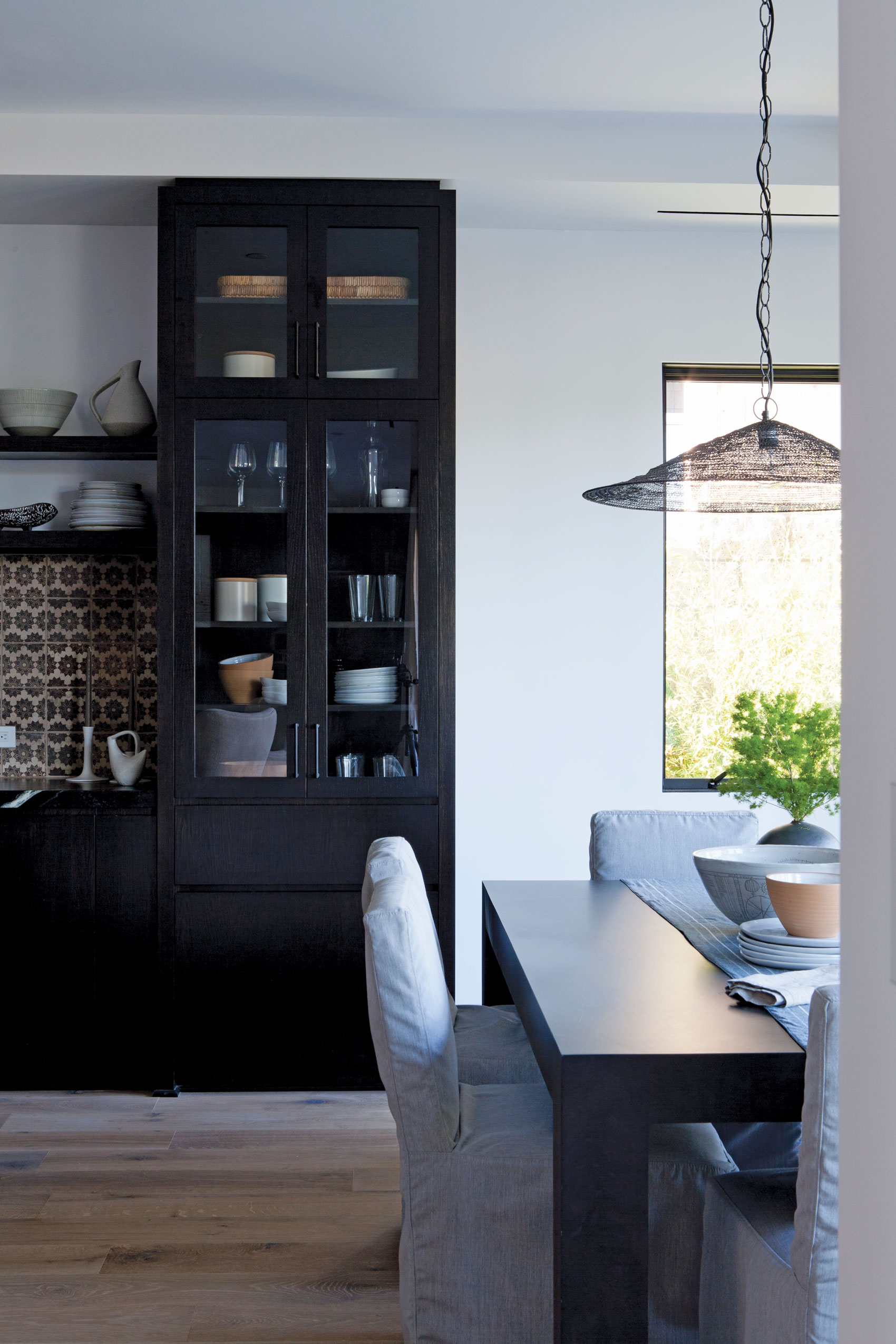 Bright Kitchen with dark accents in dining room