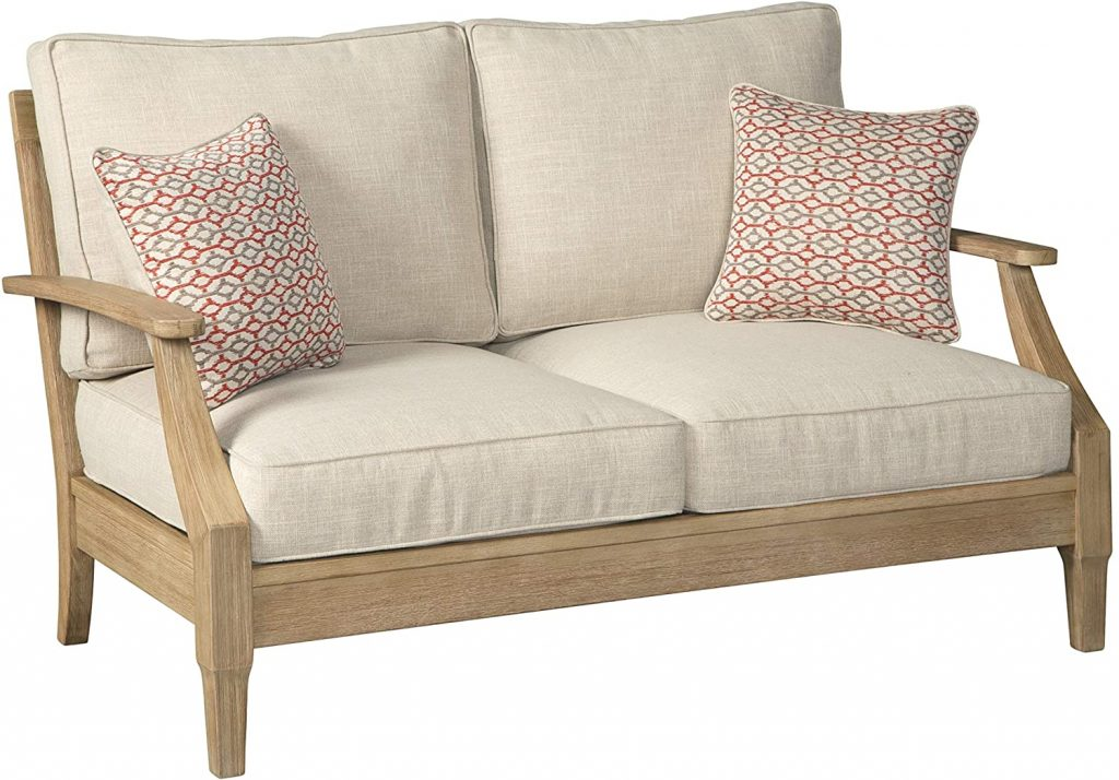 cottage patio loves seat with cream linen cushions and teak frame