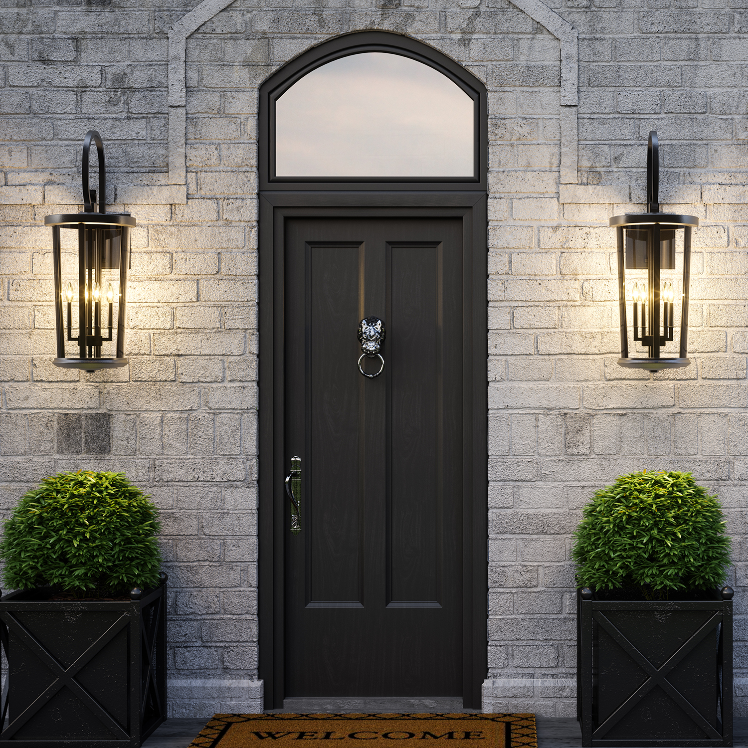 Ellsworth Lanterns lit and hanging beside the front door of a contemporary brick home
