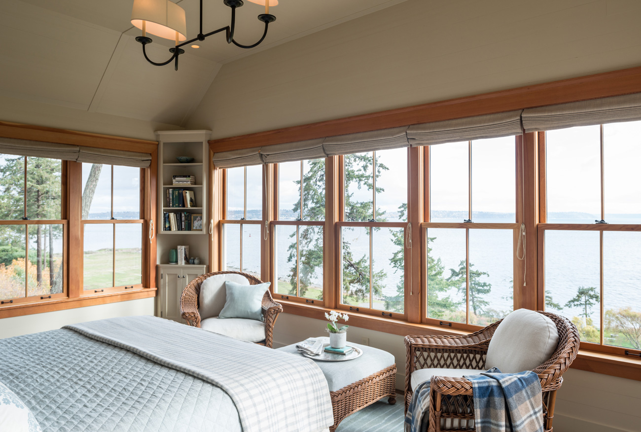Bedroom with lake view in Bainbridge Island cottage