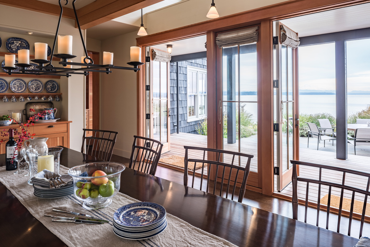 Dining Room with large open windows in the Bainbridge Island cottage