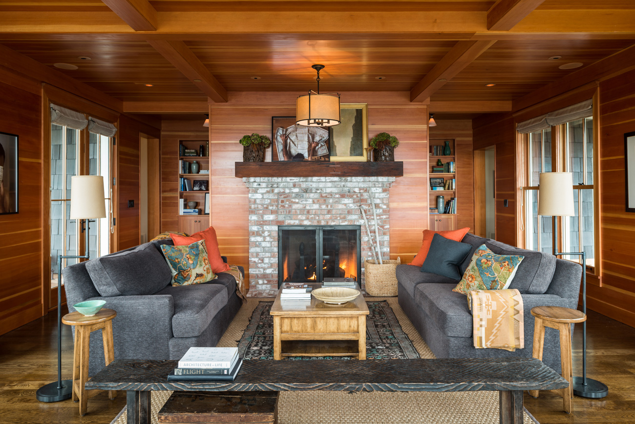Stone fireplace and wood accents in Bainbridge Island cottage