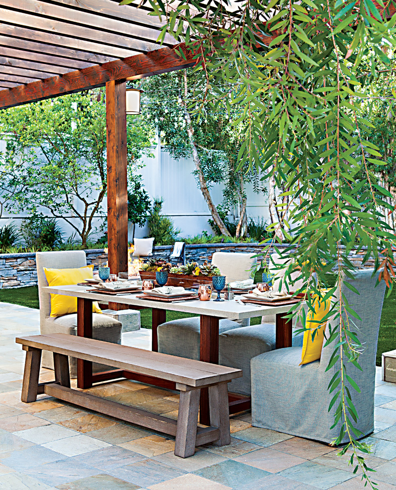 Patio dining table with blue and yellow accents