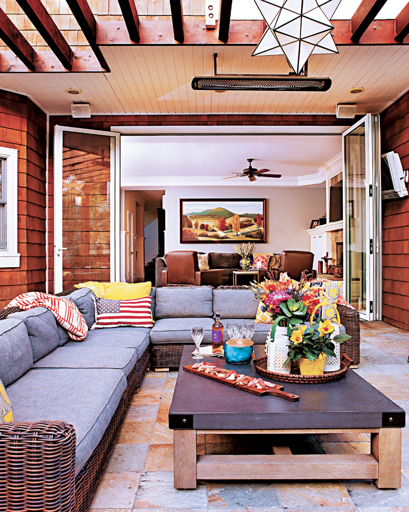 Covered patio area with outdoor tile and an outdoor couch