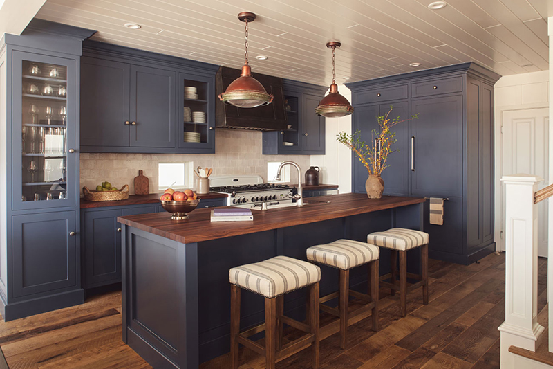 Blue cabinetry kitchen with neutral colored vintage accents