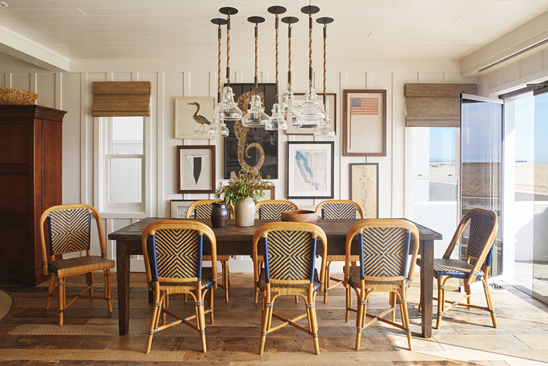 Coastal dining room with vintage explorer vibes