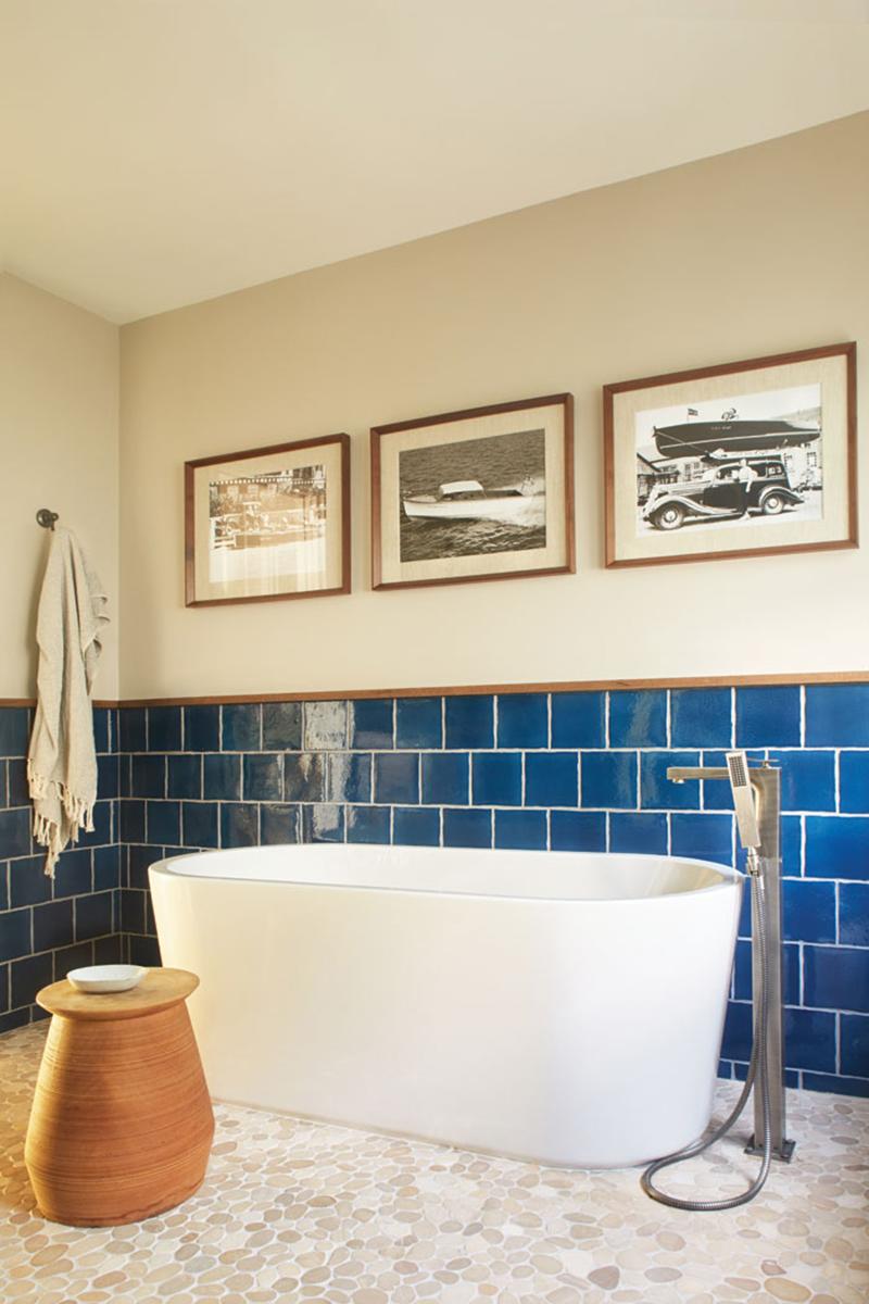 Blue bathroom wall backsplash with modern tub