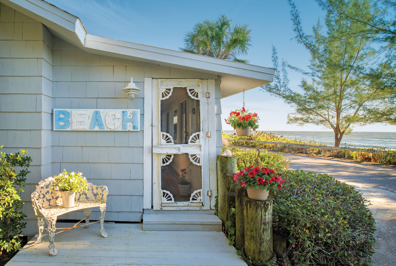 Beach bungalow entrance with front porch and intricate details