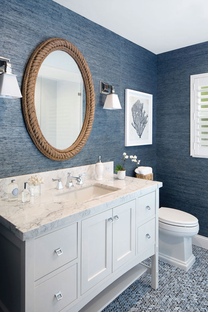 dark blue grasscloth wallpaper in renovated bathroom