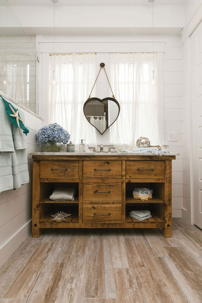 rustic wood vanity in small bathroom nook surrounded by white shiplap walls