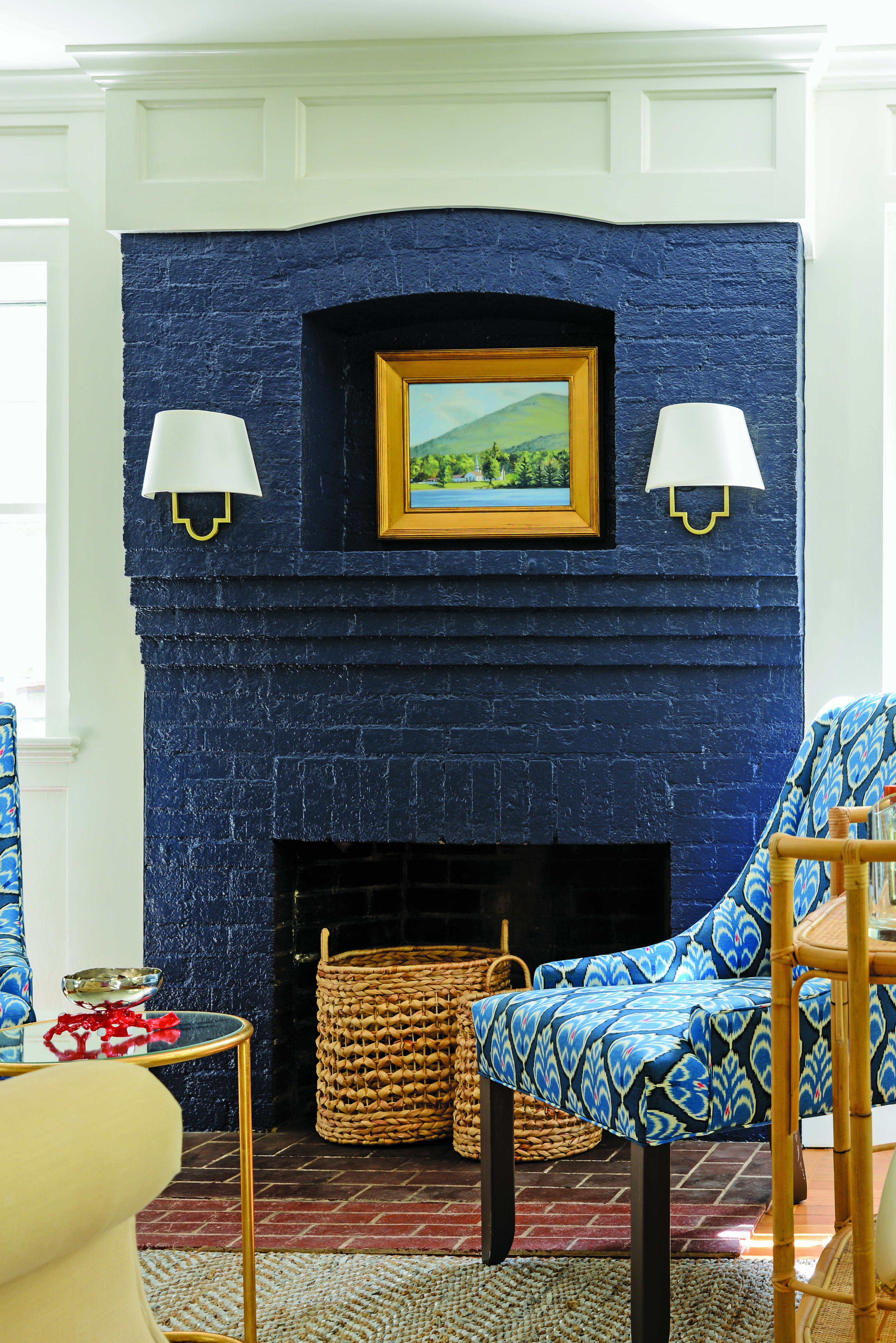This navy-blue lacquered fireplace ties in perfectly with the patterned accent chair and wall art.