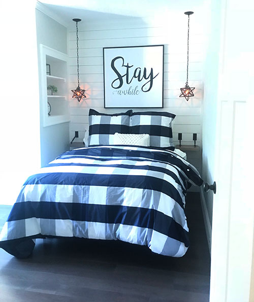 Bedroom with white shiplap wall.
