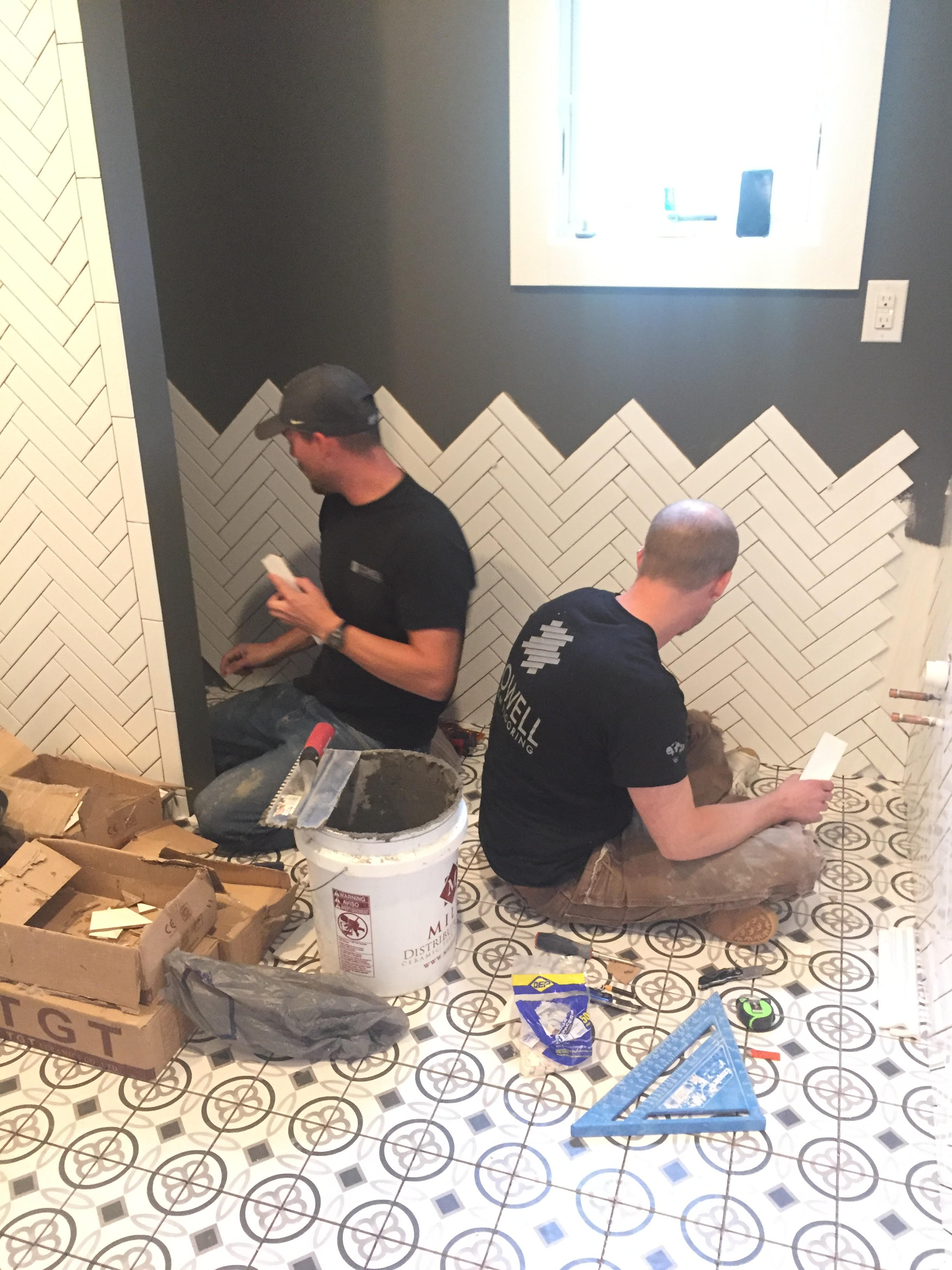 The tile floors and herringbone-pattern wall subway tile will be featured in the upstairs guest bathroom, shown here.