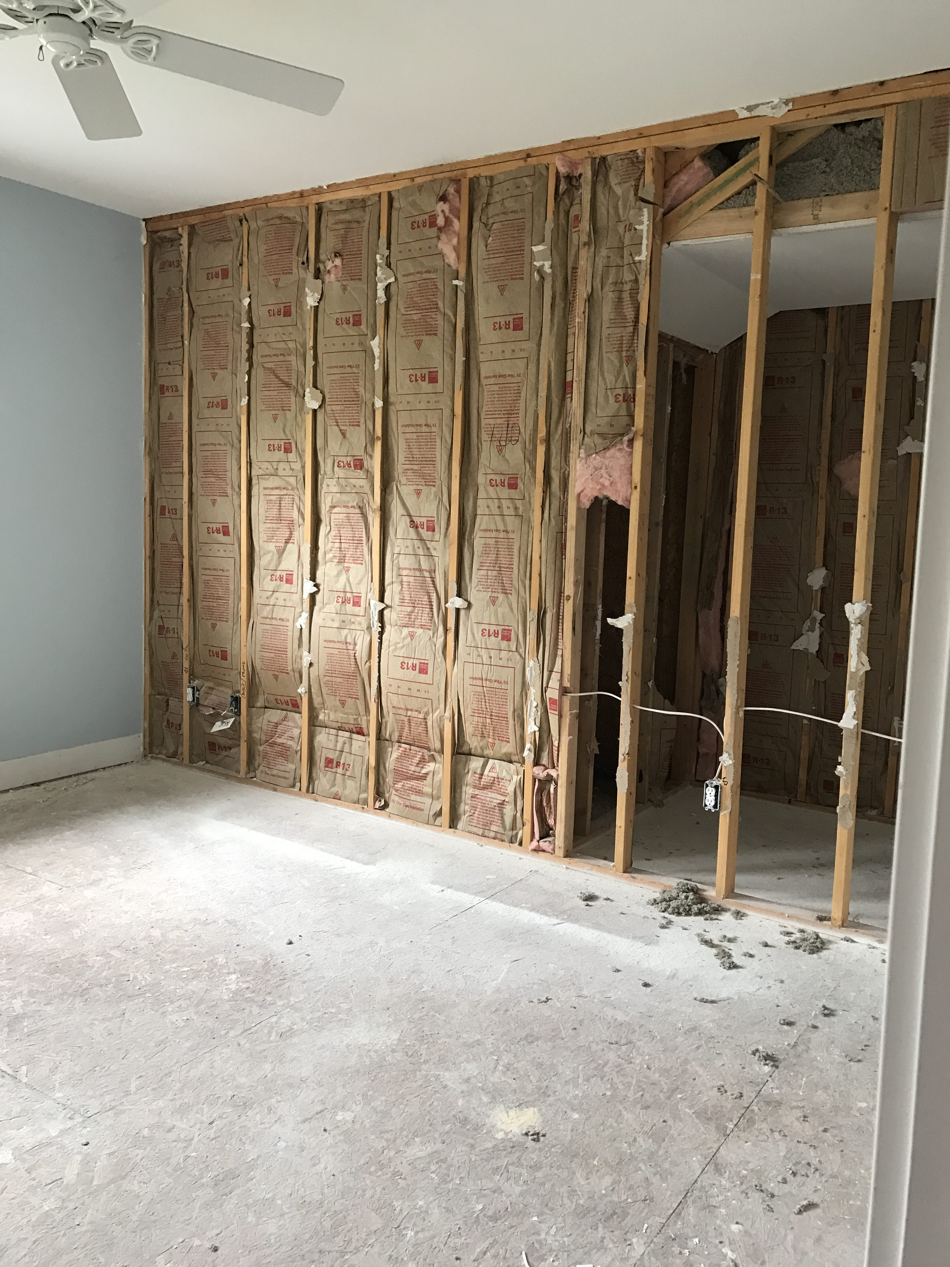 "We ""stole"" about 2 feet from this guest room to combine with the open cavity behind the original closet along with about 5 feet of the master bedroom closet accommodate a brand new master bathroom."