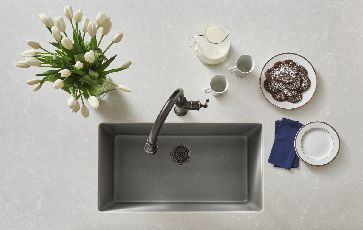 The Elkay Quartz Luxe Single Bowl Sink, shown here in Silvermist, boasts superior strength and function. These sinks are made from natural quartz and UV-stable acrylic resins, with additional organic fibers molded into the sink for added impact resistance.