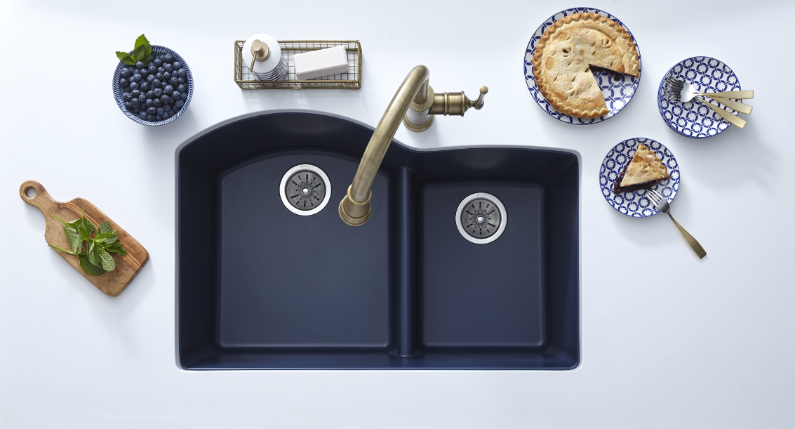 The Elkay Quartz Luxe Double Bowl Sink, shown here in rich Jubilee, boasts superior strength and function. These sinks are made from natural quartz and UV-stable acrylic resins, with additional organic fibers molded into the sink for added impact resistance.