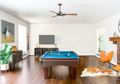 SIGNAL WITH LED LIGHT 54 INCH by Hunter Fan, shown here in a midcentury modern-style game room.