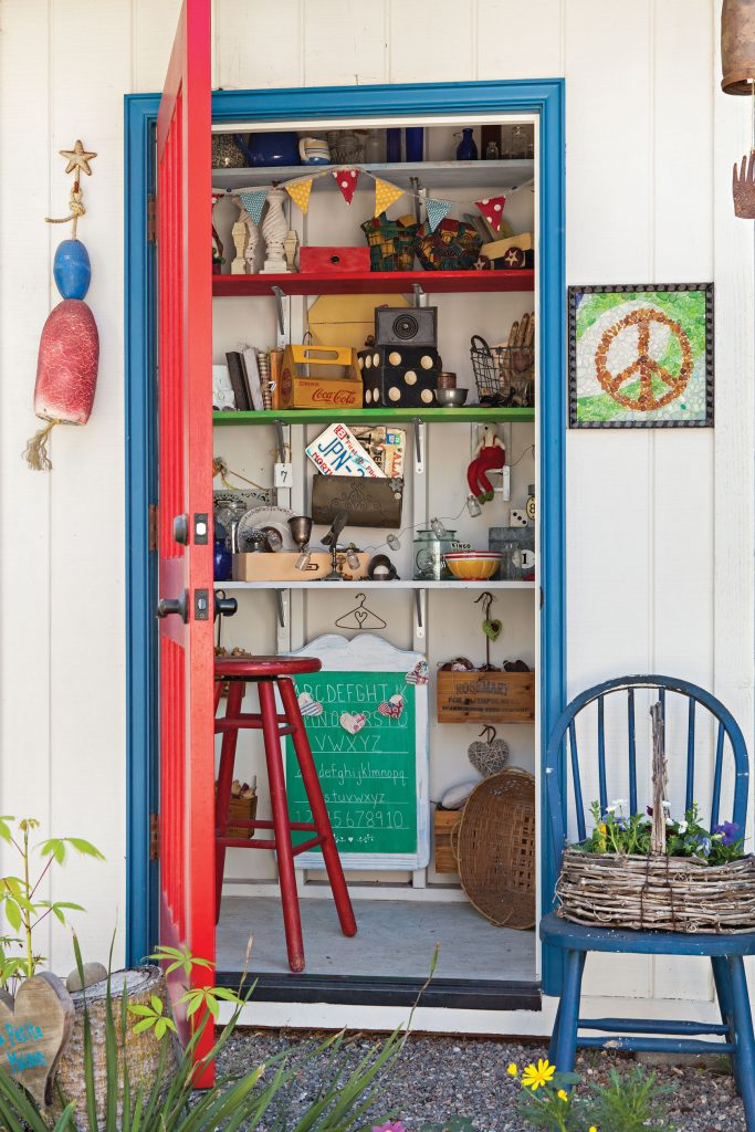 Garden shed filled with collection of knickknacks and treasures.