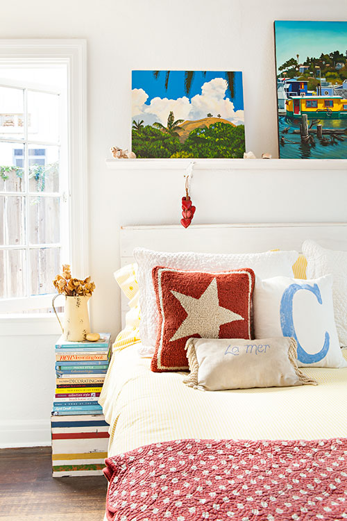 Cozy bedroom with stacked-book side table.