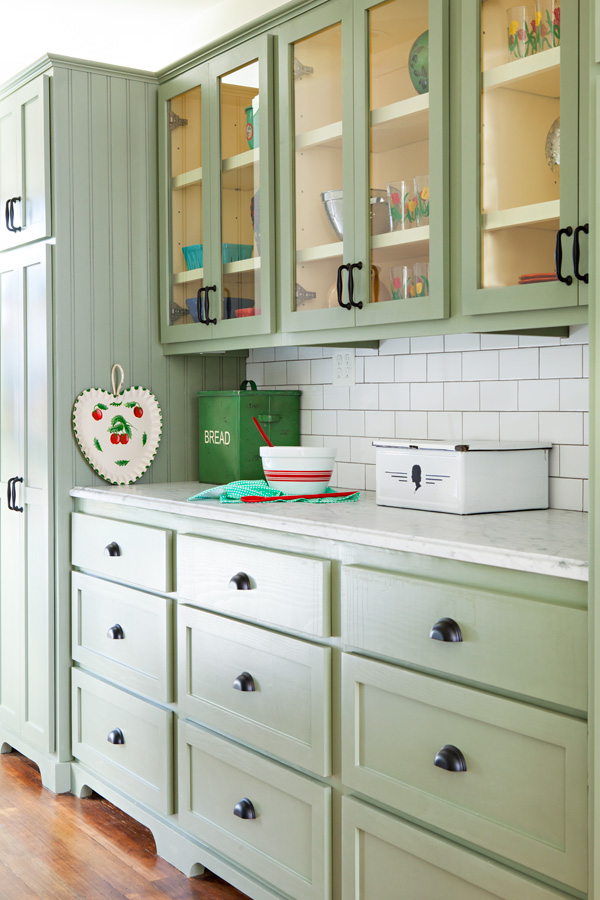bungalow butler's pantry makeover with custom soft green cabinetry with white subway tile backsplash.