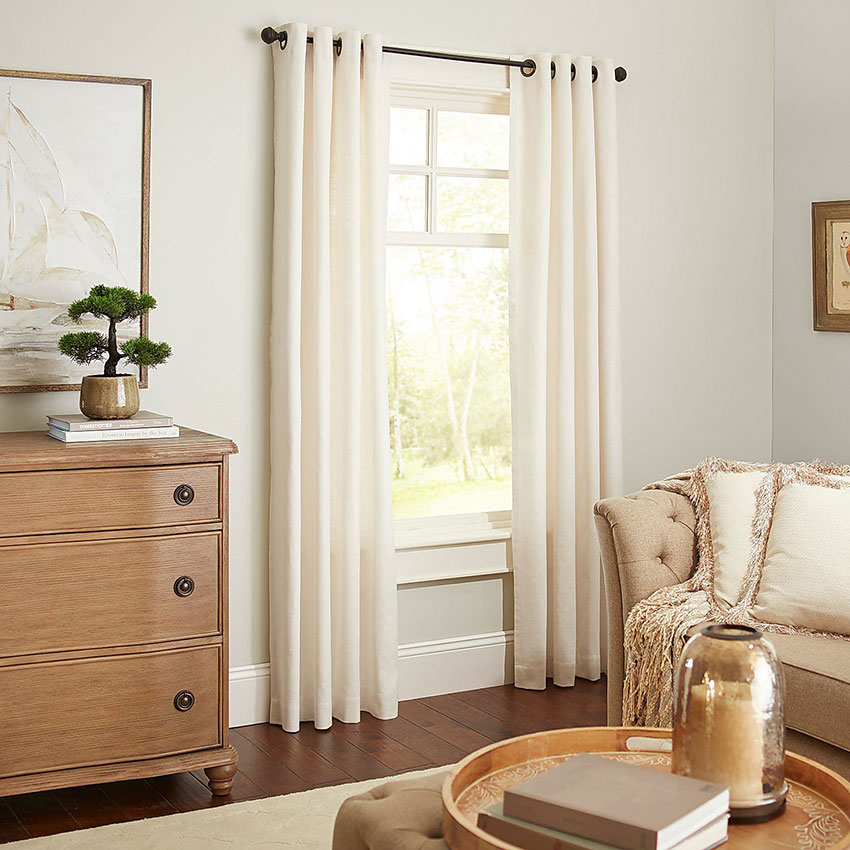 cream chambray curtains in a neutral colored living room