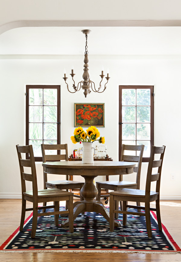 spanish bungalow dining room with chandelier