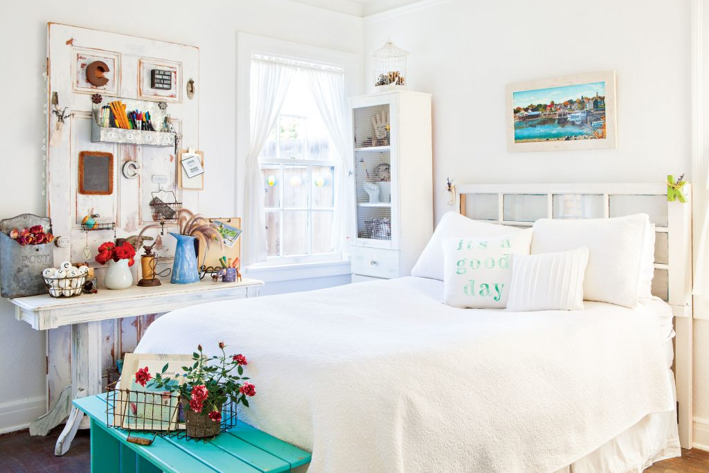 All-white guest bedroom with pops of light blue.
