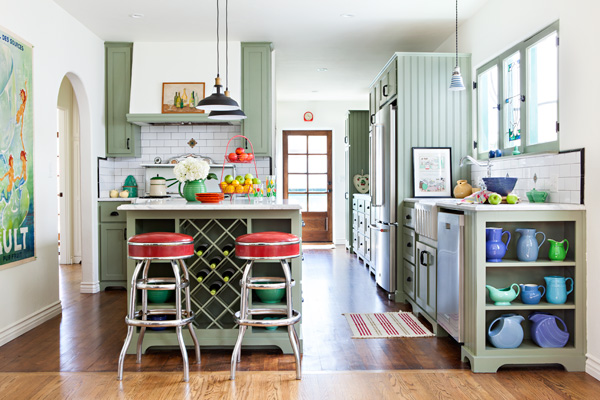 Spanish bungalow cottage kitchen makeover in light green with red vinyl barstools