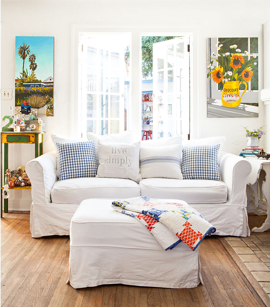 Living room with white and blue color combo.