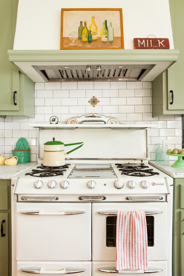 vintage stove in a bungalow kitchen makeover with light green cabinetry