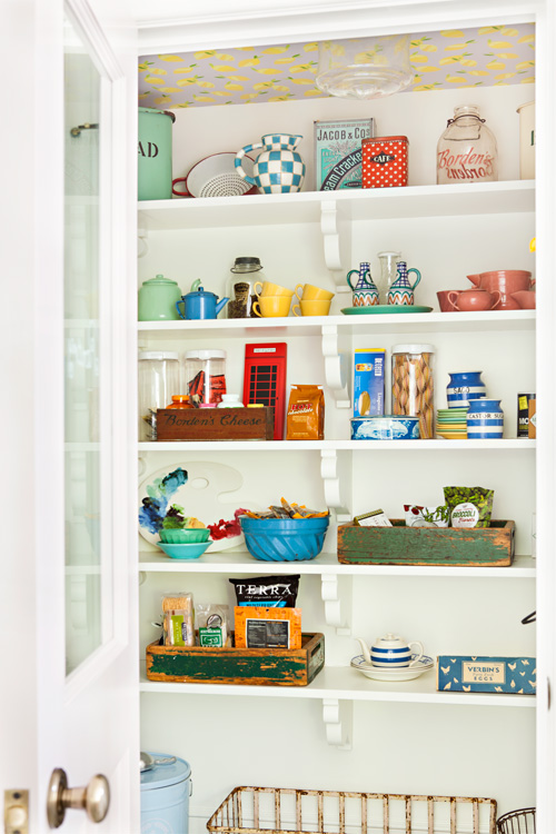 This cottage pantry is filled with vintage treasures that have been repurposed in new ways to make the most of the small space.