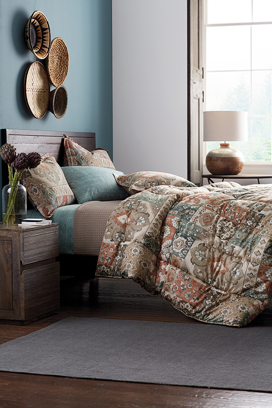 The Ankara 300-Thread Count Wrinkle-Free Sateen Down Alternative Comforter Collection from The Company Store, shown here, combine bold patterns and warm colors that are perfect for fall.