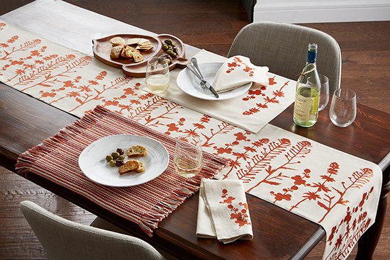 A warm tablescape created by using the Nature Embroidered Table Runner and Aston Stripe Table Placements from the Company Store.