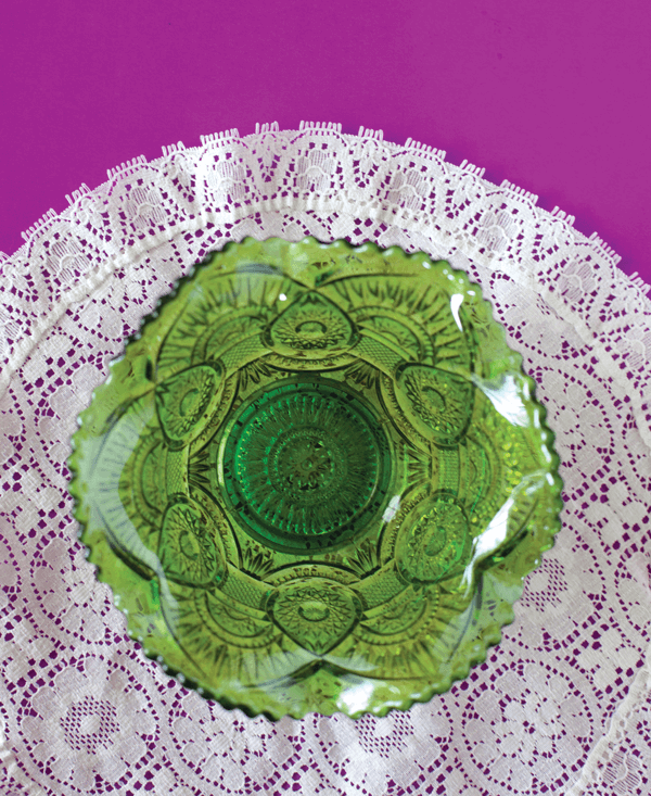 The intricate patterns on pieces such as this green carnival glass bowl made seemingly lavish home accents achievable for everyone.