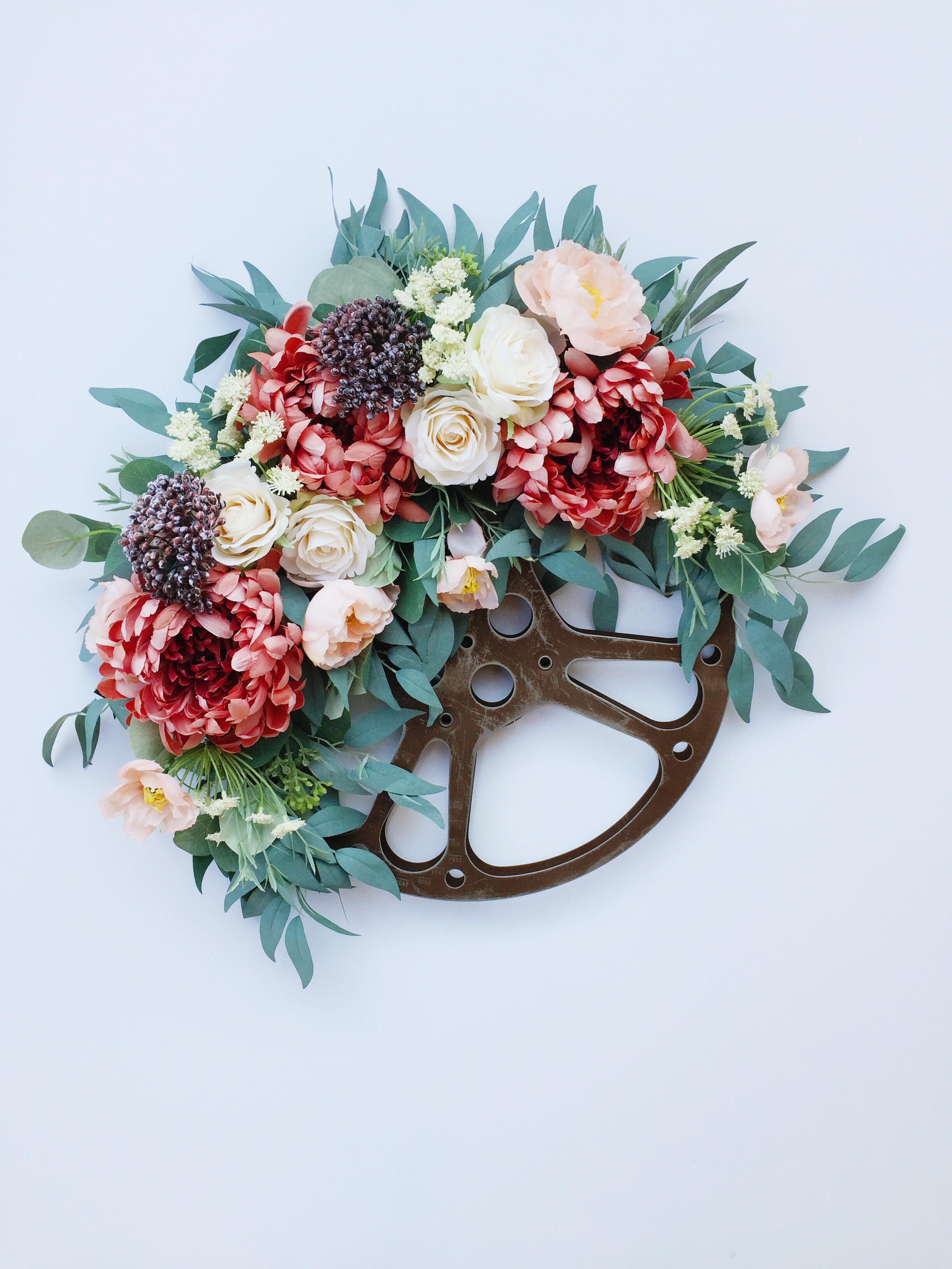 Round floral decorative wreath with greenery from Bloom Valley Market.